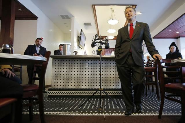 U.S. Senator Rand Paul (R-KY), a 2016 Republican White House hopeful, listens to a question while speaking to a group of state legislators at Murphy's Diner in Manchester, New Hampshire January 14 ...