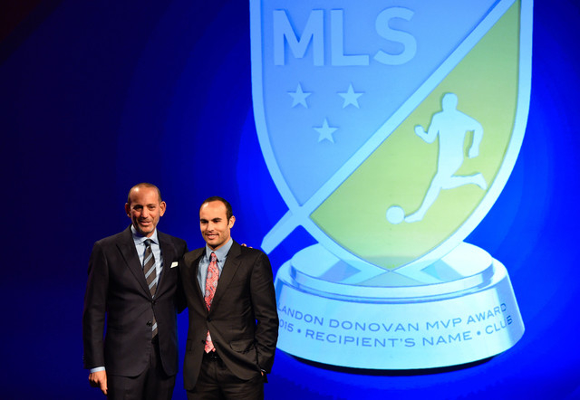 Jan 15, 2015; Philadelphia, PA, USA; MLS commissioner Don Garber (left) and Landon Donovan (right) pose for a photo in front of the 2015 MVP award during the Landon Donovan MVP award tribute event ...