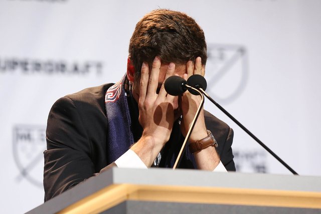 Jan 15, 2015; Philadelphia, PA, USA; Matt Polster takes a moment to gather himself after being selected as the number seven overall pick by the Chicago Fire in the 2015 MLS SuperDraft at Philadelp ...