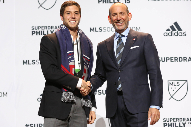 Jan 15, 2015; Philadelphia, PA, USA; Matt Polster shakes hands with commissioner Don Garber after being selected as the number seven overall pick by the Chicago Fire in the 2015 MLS SuperDraft at  ...