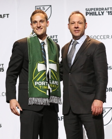 Jan 15, 2015; Philadelphia, PA, USA; Christian Volesky poses with executive vice president J. Todd Durbin after being selected 12th in the second round and 32nd overall by the Portland Timbers in  ...