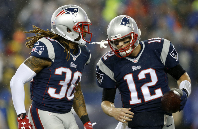 New England Patriots quarterback Tom Brady (12) celebrates with running back Brandon Bolden (38) after throwing a touchdown pass during the third quarter against the Indianapolis Colts in the AFC  ...