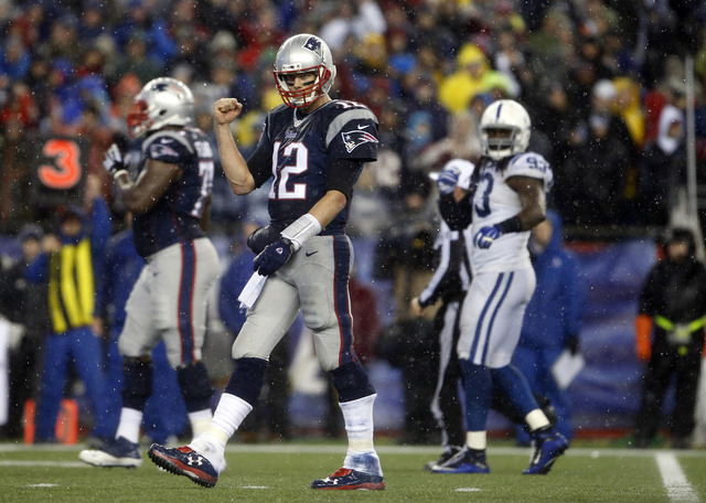 New England Patriots quarterback Tom Brady (12) pumps his fist as he heads up to the line against the Indianapolis Colts in the second half in the AFC Championship Game at Gillette Stadium, Jan 18 ...