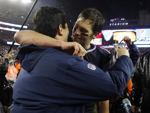 New England Patriots quarterback Tom Brady (12) is congratulated by former linebacker Tedy Bruschi, left, after the AFC Championship Game against the Indianapolis Colts at Gillette Stadium.(David  ...