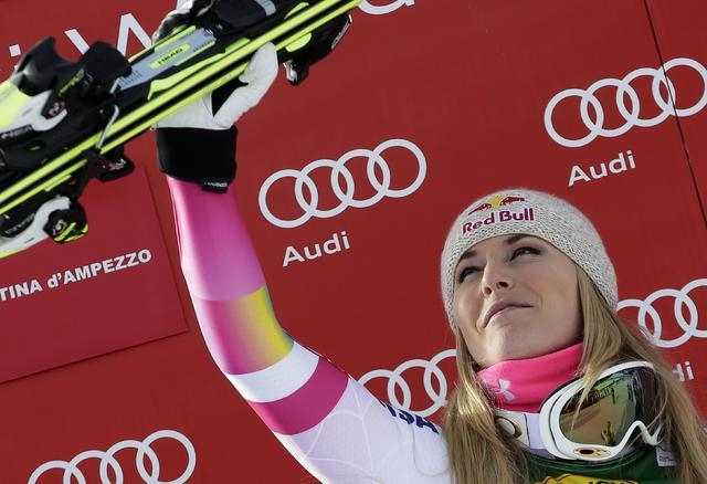 Lindsey Vonn of the U.S. celebrates on the podium after winning the women's World Cup Super-G skiing race in Cortina D'Ampezzo January 19, 2015. Vonn became the most successful female in Alpine sk ...