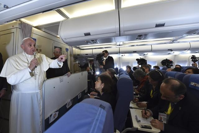Pope Francis gestures as he speaks with journalists on his flight back from Manila to Rome, January 19, 2015. (REUTERS/Giuseppe Cacace/Pool)