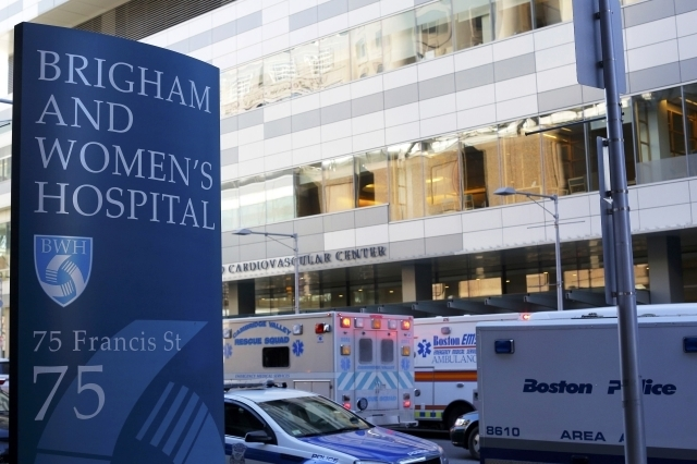 Police and ambulance vehicles surround the building where a shooting occurred at Brigham and Women's hospital in Boston, Tuesday, Jan. 20, 2015. One person has been shot and the suspected shooter  ...