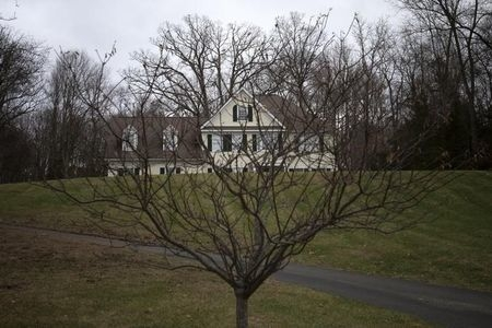 The house where Adam Lanza lived with his mother Nancy Lanza is seen in Newtown, Connecticut, Dec. 14, 2014. Newtown officials will vote Wednesday, Jan. 21, 2015, on whether to demolish the house. ...