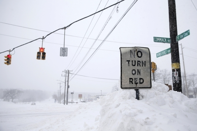 Snow is seen piled up on a snowbank in the Suffolk County town of Dix Hills, New York, Tuesday, Jan. 27, 2015. A blizzard swept across the northeastern United States, dropping more than a foot of  ...