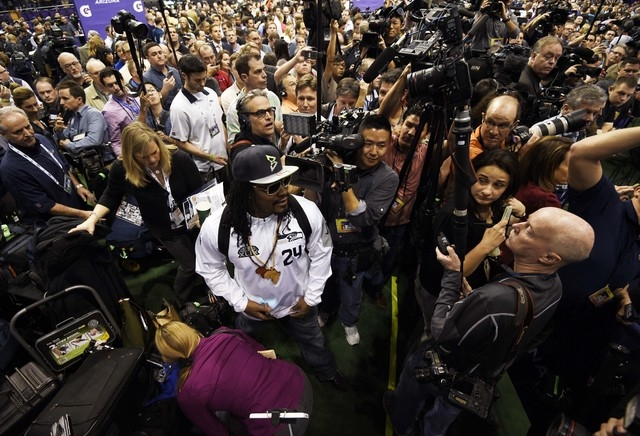 Seattle Seahawks running back Marshawn Lynch arrives for media day for Super Bowl XLIX at US Airways Center in Phoenix. (Kyle Terada-USA TODAY Sports)