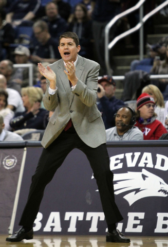 Jan 27, 2015; Reno, NV, USA; Runnin' Rebel head coach Dave Rice calls in a play during the first half of their NCAA basketball game with the Nevada Wolf Pack at Lawlor Events Center. Mandat ...