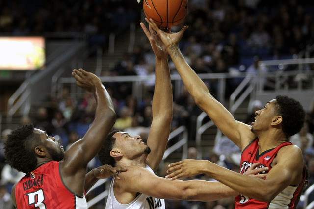 Jan 27, 2015; Reno, NV, USA; Nevada Wolf Pack forward AJ West (3) fights for a rebound with UNLV Runnin' Rebel forward Christian Wood (5) and guard Jordan Cornish (3) in the first half of their NC ...