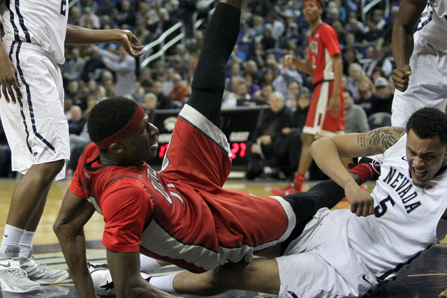 Jan 27, 2015; Reno, NV, USA; UNLV Runnin' Rebel center Goodluck Okonoboh (11) collides with Nevada Wolf Pack forward Kaileb Rodriguez (5) in the first half of their NCAA basketball game at Lawlor  ...