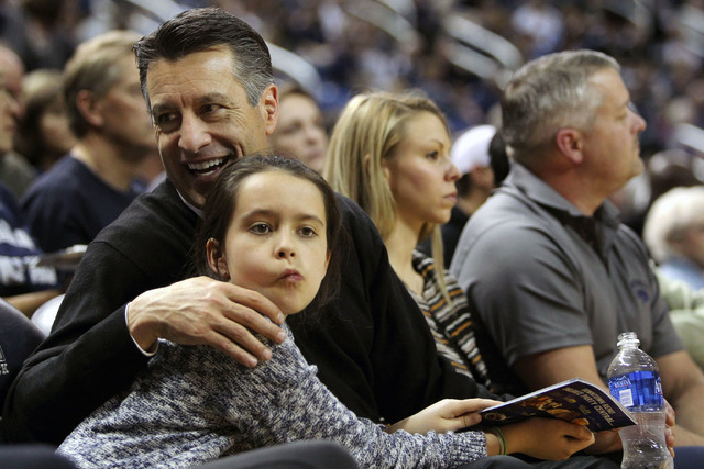Jan 27, 2015; Reno, NV, USA; Nevada Governor Brian Sandoval and his youngest daughter Marisa age 10 sit courtside as Nevada Wolf Pack played the UNLV Runnin' Rebel's in the Governor's series at La ...