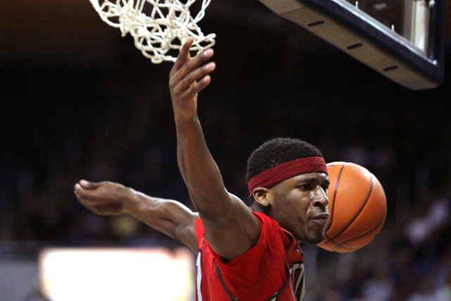 Jan 27, 2015; Reno, NV, USA; UNLV Runnin' Rebel forward Goodluck Okonoboh (11) scores during the second half of their NCAA basketball game with the Nevada Wolf Pack at Lawlor Events Center. Mandat ...