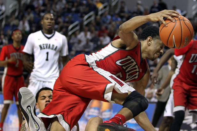Jan 27, 2015; Reno, NV, USA; UNLV Runnin' Rebel forward Christian Wood (5) is fouled by Nevada Wolf Pack forward Kaileb Rodriguez (5) in the second half of their NCAA basketball game at Lawlor Eve ...