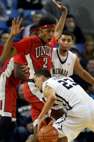 Jan 27, 2015; Reno, NV, USA; Nevada Wolf Pack guard Michael Perez (23) is fouled by UNLV Runnin' Rebel guard Patrick McCaw (2) in the second half of their NCAA basketball game at Lawlor Events Cen ...