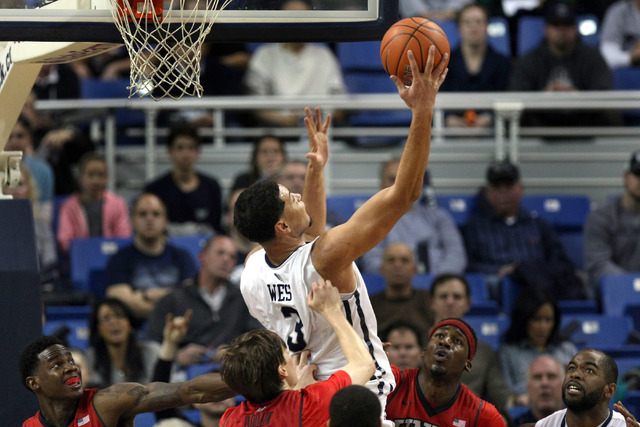 Jan 27, 2015; Reno, NV, USA; Nevada Wolf Pack forward AJ West (3) recovers a Nevada rebound in front of UNLV Runnin' Rebel forward Christian Wood (5) in the second half of their NCAA basketball ga ...