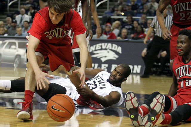 Jan 27, 2015; Reno, NV, USA; UNLV Runnin' Rebel guard Cody Doolin (45) recovers a Nevada Wolf Pack loose ball in front of Nevada center Ronnie Stevens (33) in the first half of their NCAA basketba ...