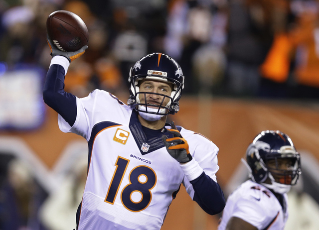 Denver Broncos quarterback Peyton Manning throws during the first half of an NFL football game against the Cincinnati Bengals on Monday, Dec. 22, 2014, in Cincinnati. (AP Photo/Michael Conroy)
