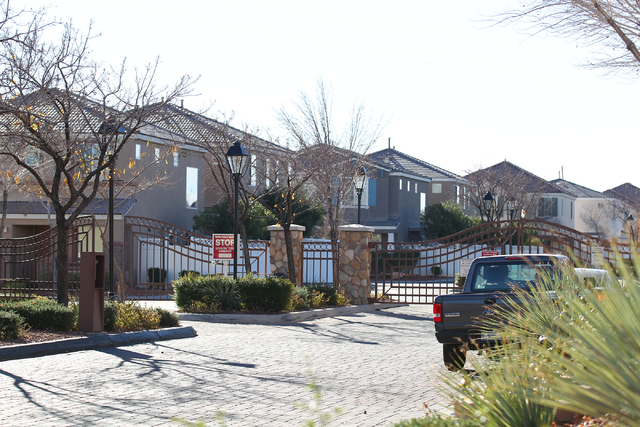 The entrance to the gated community where a man and woman were found dead in a home on the 6200 block of Glimmering Lights Avenue in Las Vegas is seen on Wednesday, Jan. 7, 2015. (Chase Stevens/La ...