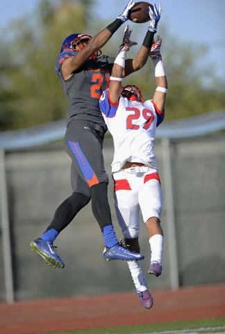 Liberty defensive back Jake Dedeaux (29) breaks up a touchdown pass intended for Bishop Gorman wide receiver Cordell Broadus (21) in the first half of their Division I state football semifinal gam ...