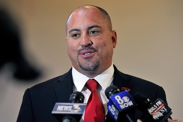 Tony Sanchez smiles as he speaks with the media after the Board of Regents approved his contract to become the UNLV football coach on Tuesday, Dec. 16, 2014, in Las Vegas. (David Becker/Las Vegas  ...