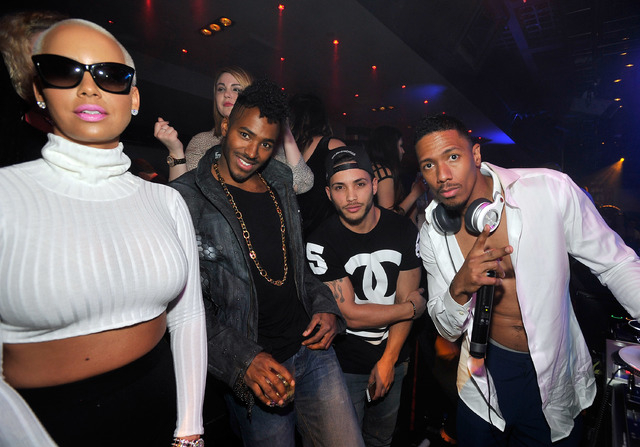 Model Amber Rose, DJ Ruckus, DJ Cassidy and actor/DJ Nick Cannon, left to right) appear at 1 OAK Nightclub at The Mirage Hotel & Casino on Jan. 6, 2015.  (Photo by David Becker/WireImage)