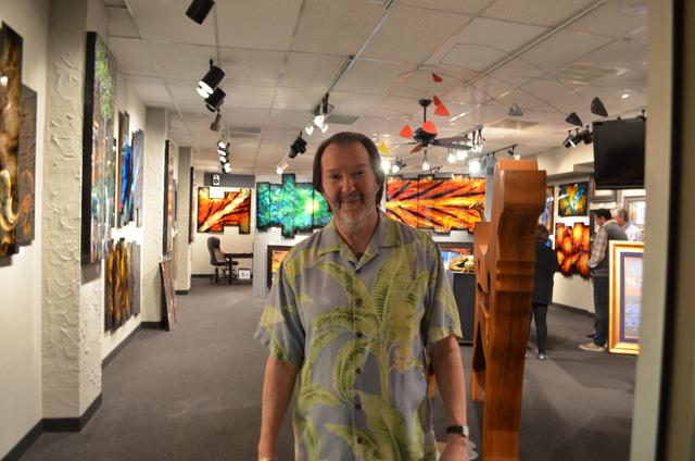 Phil Sacks, gallery director and partner at DeRubeis Fine Art of Metal, welcomes visitors to Scottsdale's Thursday night ArtWalk. (Ginger Meurer/Las Vegas Review-Journal)