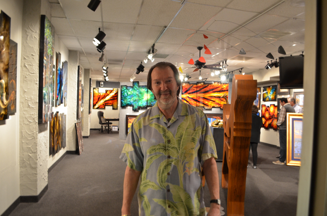 Phil Sacks, gallery director and partner at DeRubeis Fine Art of Metal, welcomes visitors to Scottsdale's Thursday night ArtWalk. (Ginger Meurer/Las Vegas Review-Journal)
