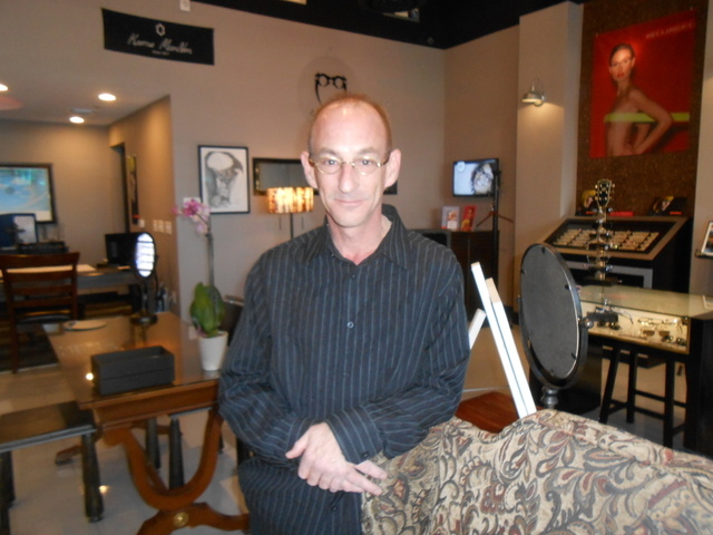 Dr. Edward Malik stands inside Eyes & Optics, his new optometry office in Downtown Summerlin, Nov. 24, 2014. By night, Malik is the drummer for local rock band The Melancholics. (Jan Hogan/View) ( ...