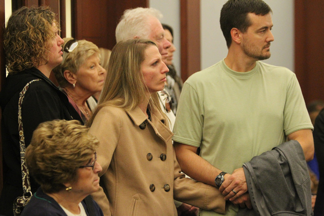 Family members of Elliott Smith listen during the sentencing hearing of Ivy Rasmussen and her husband Robert Ballew at the Regional Justice Center in Las Vegas Wednesday, Jan. 14, 2015. The couple ...