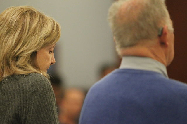 Ivy Rasmussen, left, with her husband Robert Ballew, listen during their sentencing hearing at the Regional Justice Center in Las Vegas Wednesday, Jan. 14, 2015. Rasmussen and her husband Robert B ...