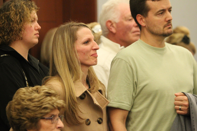 Family members of Elliott Smith react to the sentencing of Ivy Rasmussen and her husband Robert Ballew at the Regional Justice Center in Las Vegas Wednesday, Jan. 14, 2015. The couple was sentence ...