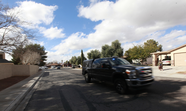 An unmarked police vehicle arrives at a barricade situation on the 5600 block of Blue Sea Street near the intersection of Charleston and Nellis boulevards, in Las Vegas on Tuesday, Jan. 27, 2015.  ...
