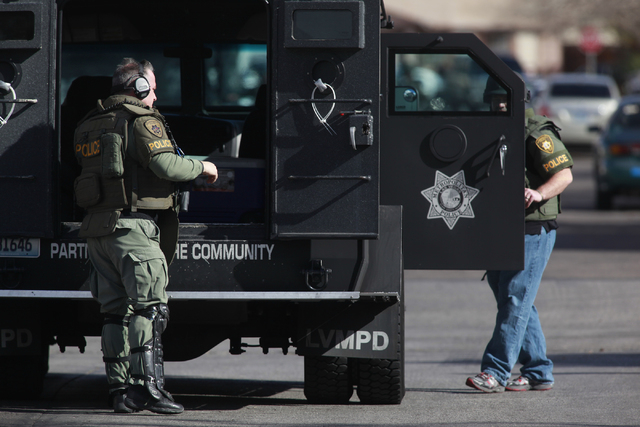 Las Vegas SWAT officers arrive at a barricade situation on the 5600 block of Blue Sea Street near the intersection of Charleston and Nellis boulevards, in Las Vegas on Tuesday, Jan. 27, 2015. A ma ...