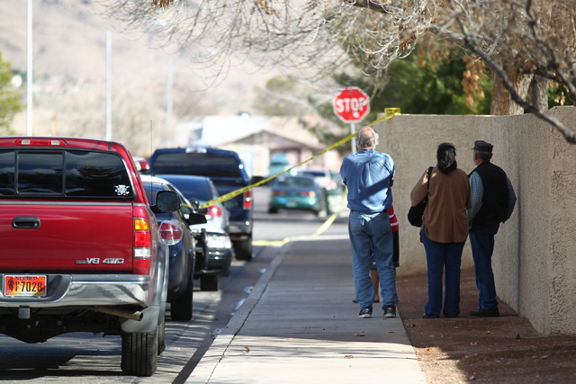 Area residents watch as Las Vegas police and SWAT officers respond to a barricade situation on the 5600 block of Blue Sea Street near the intersection of Charleston and Nellis boulevards, in Las V ...