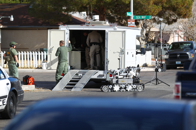Las Vegas police and SWAT officers respond to a barricade situation on the 5600 block of Blue Sea Street near the intersection of Charleston and Nellis boulevards, in Las Vegas on Tuesday, Jan. 27 ...