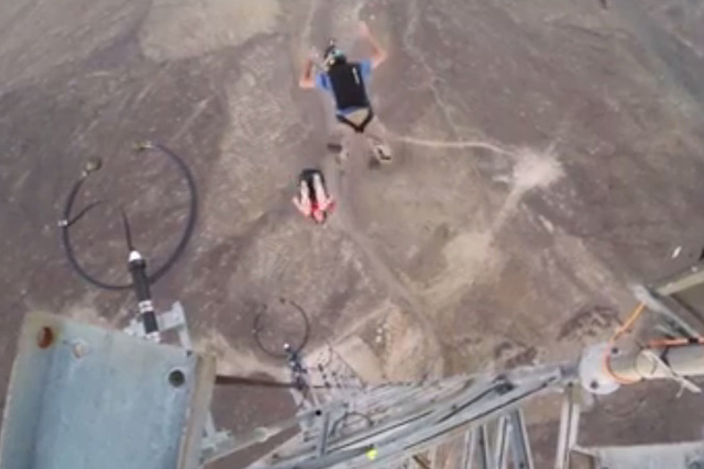 Experienced base jumpers J.T. Homes and Mark Broderick climbed the rural Idaho tower with no intentions of climbing back down. Once they reached the top, they took the fastest way down. (Screengra ...