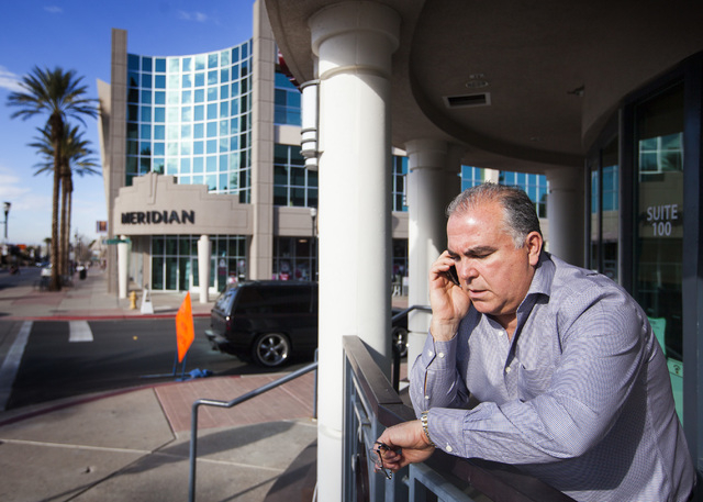 Tim Brooks, owner of a Pinnacle Building at 203 Water Street in Henderson, talks on the phone on Friday, Jan. 9, 2014. The building was the site of the former Berwick's restaurant that had been to ...