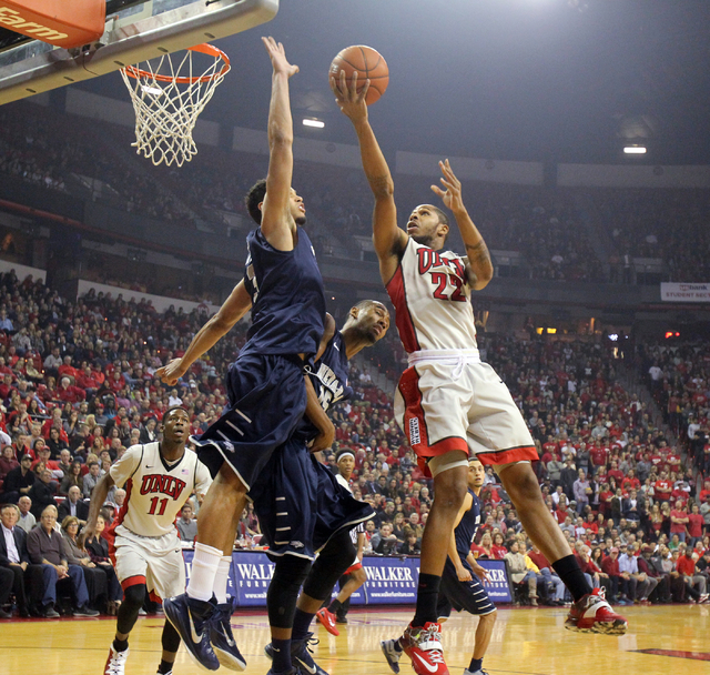 UNLV guard Jelan Kendrick goes up for a shot in front of UNR forward A.J. West in the first half of their basketball game Wednesday, Jan. 7, 2015, at the Thomas & Mack Center in Las Vegas. (K.M. C ...