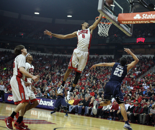 UNLV forward Christian Wood blocks tries to block a shot by UNR guard Michael Perez in the first half of their basketball game Wednesday, Jan. 7, 2015, at the Thomas & Mack Center in Las Vegas. Lo ...