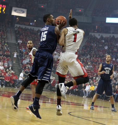 UNLV guard Rashad Vaughn runs into UNR guard D.J. Fenner while defending in the first half of their basketball game Wednesday, Jan. 7, 2015, at the Thomas & Mack Center in Las Vegas. (Sam Morris/L ...