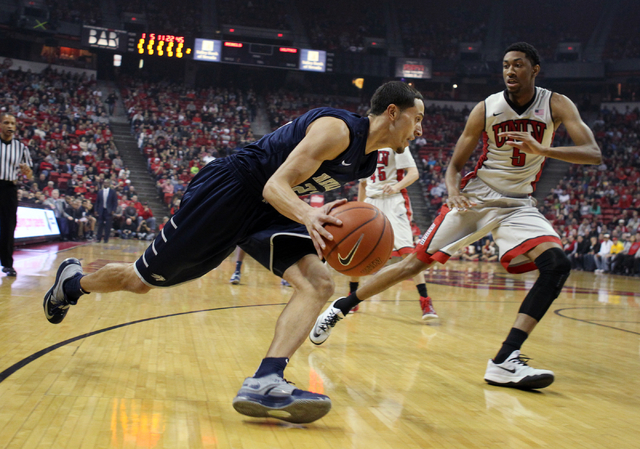 UNLV forward Christian Wood defends UNR guard Michael Perez in the first half of their basketball game Wednesday, Jan. 7, 2015, at the Thomas & Mack Center in Las Vegas. Looking on are UNLV forwar ...