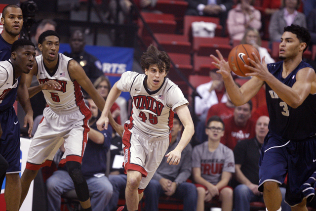 UNR forward A.J. West grabs a loose ball in front of UNLV forward Christian Wood (5) and UNLV guard Cody Doolin (45) in the first half of their basketball game Wednesday, Jan. 7, 2015, at the Thom ...
