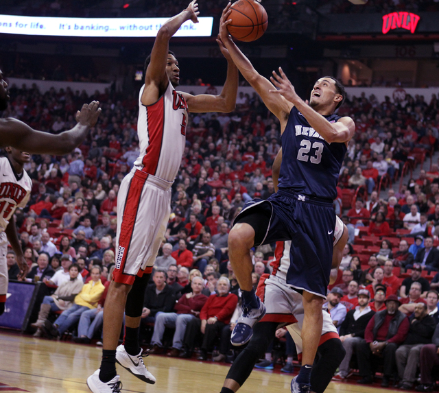 UNR guard Michael Perez goes up for a shot in front of UNLV forward Christian Wood in the first half of their basketball game Wednesday, Jan. 7, 2015, at the Thomas & Mack Center in Las Vegas. (Sa ...