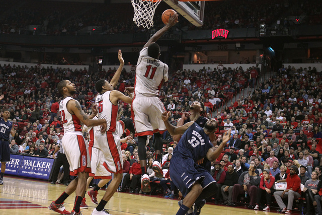 UNLV forward Goodluck Okonoboh blocks a shot by UNR center Ronnie Stevens Jr. during their Mountain West Conference basketball game Wednesday, Jan. 7, 2015, at the Thomas & Mack Center. (Sam Morri ...