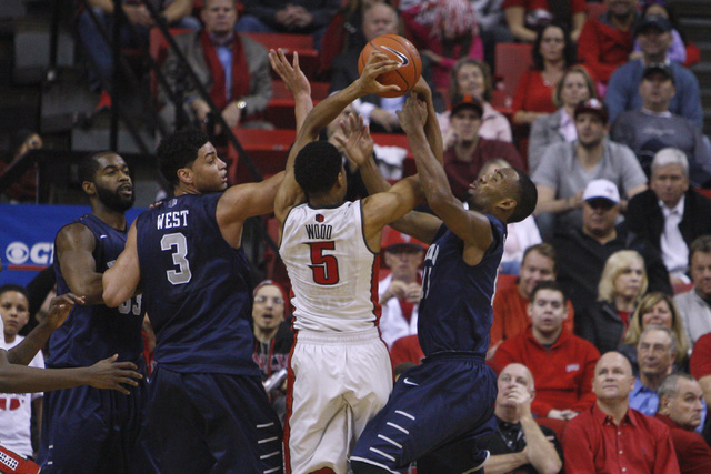 UNR forward A.J. West, UNLV forward Christian Wood and  UNR guard D.J. Fenner fight for a reboud during their Mountain West Conference basketball game Wednesday, Jan. 7, 2015, at the Thomas & Mack ...