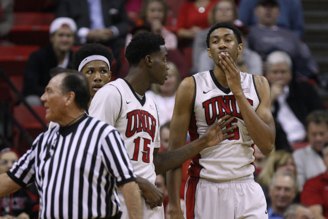 UNLV forward Christian Wood rubs his chin after being elbowed by UNR forward Lucas Stivrins during their Mountain West Conference basketball game Wednesday, Jan. 7, 2015, at the Thomas & Mack Cent ...