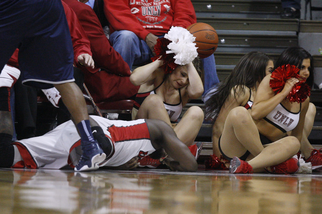 Cheerleaders react as UNLV guard Jordan Cornish  and the ball fly out of bounds during their Mountain West Conference basketball game against UNR Wednesday, Jan. 7, 2015, at the Thomas & Mack Cent ...